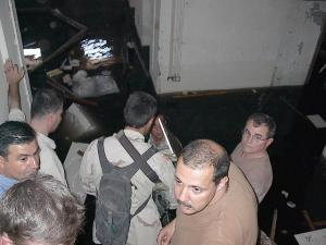 Military entering the flooded Mukhabarat basement on May 6, 2003. Photo courtesy of Harold Rhode